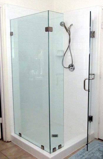 a 90 degree frameless shower was a great choice for this bathroom