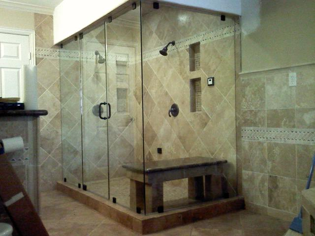 Large frameless 90 degree shower.